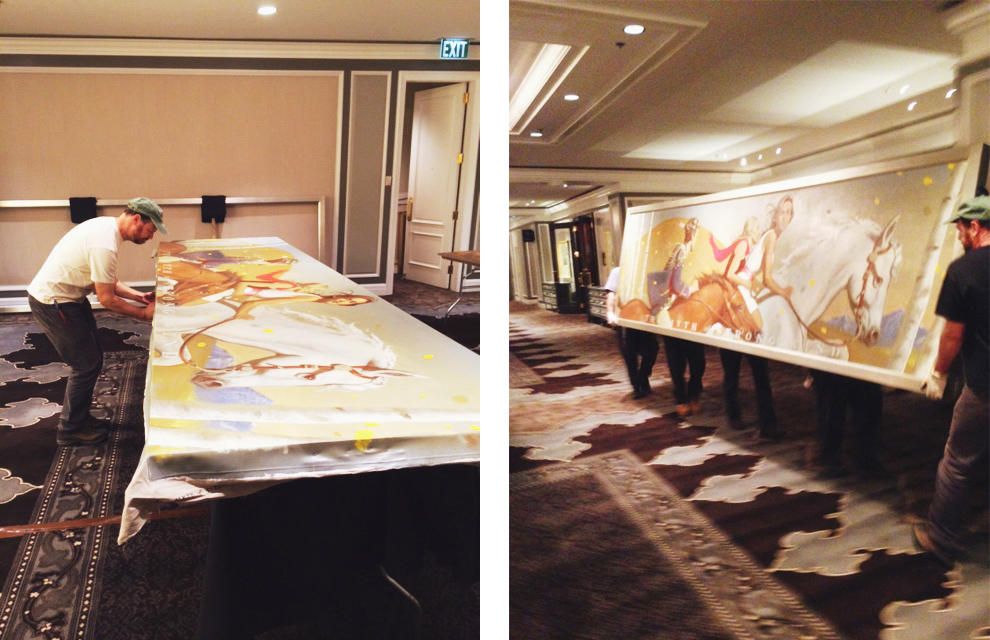 Allison and Ross stretching and installing a Bo Bartlett mural on canvas at the St. Regis in Aspen